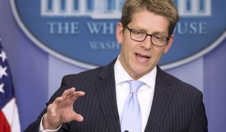 White House press secretary Jay Carney gestures during the daily press briefing, Monday, Nov. 18, 2013, at the White Hosue in Washington. Carney answered questions about the ongoing rollout of the new healthcare law. (AP Photo/ Evan Vucci)