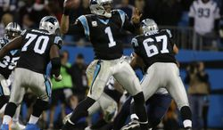 Carolina Panthers quarterback Cam Newton (1) works against the New England Patriots during the second half of an NFL football game in Charlotte, N.C., Monday, Nov. 18, 2013. (AP Photo/Bob Leverone)