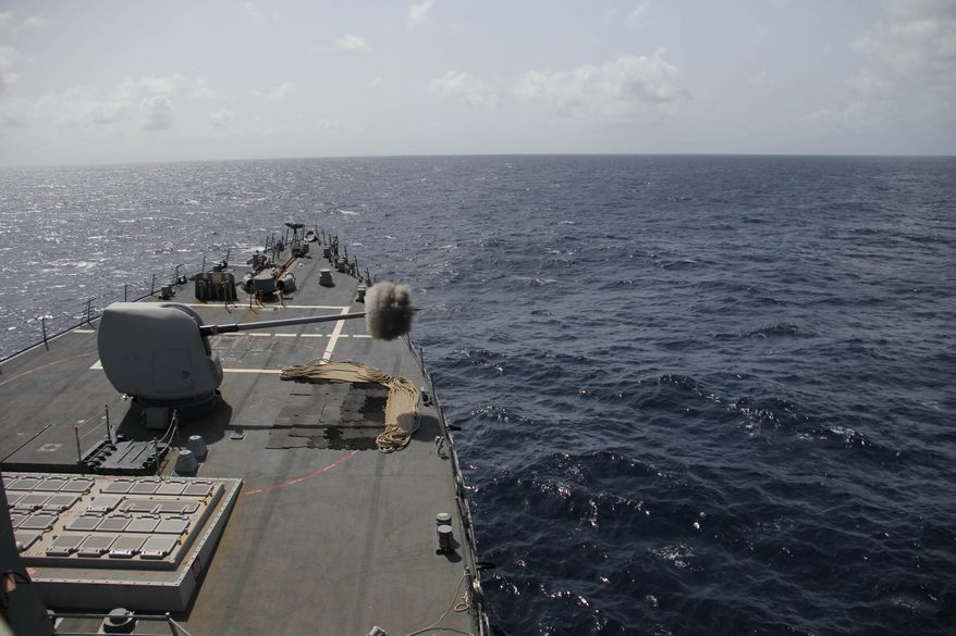 ** FILE ** The guided-missile destroyer USS Gonzalez (DDG 66) fires a 5-inch round during a live-fire exercise in the Indian Ocean. (U.S. Navy photo by Lt. j.g. Jon Bullough/Released)