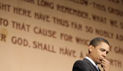** FILE ** Then-Sen. Barack Obama, Illinois Democrat, with the Gettysburg Address behind him, waits to speak at the Soldiers and Sailors Museum and Memorial in Pittsburgh on March 28, 2008. (Associated Press)