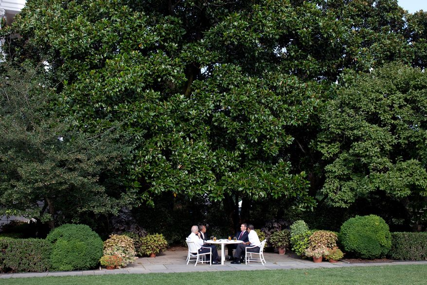 President Barack Obama and Vice President Joe Biden have a beer with Harvard professor Henry Louis Gates Jr. and Cambridge, Mass., police Sgt. James Crowley in the Rose Garden of the White House on July 30, 2009