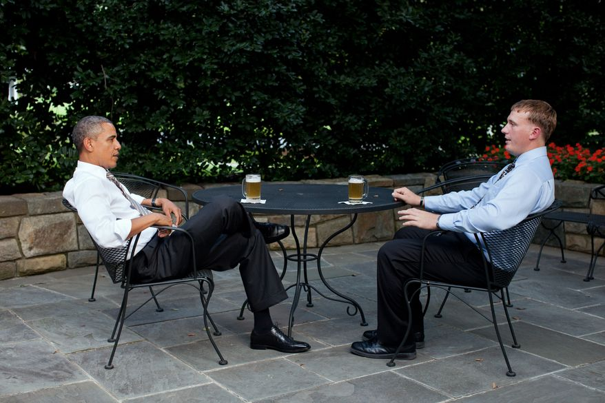 President Barack Obama enjoys a beer with Dakota Meyer on the patio outside of the Oval Office, Sept. 14, 2011. The President will present Meyer with the Medal of Honor tomorrow during a ceremony at the White House. (Official White House Photo by Pete Souza)