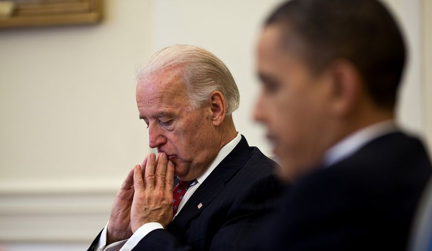 President Barack Obama and Vice President Joe Biden meet with advisors for a health care implementation meeting in the Oval Office, March 30, 2010. (Official White House Photo by Pete Souza)