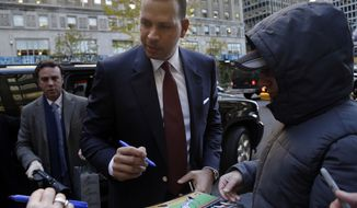 Alex Rodriguez signs autographs as he arrives at Major League Baseball headquarters in New York, Tuesday, Nov. 19, 2013. Rodriguez's grievance hearing to overturn his 211-game suspension resumed Monday with the first of what could be 10 straight days of sessions. (AP Photo/Seth Wenig)