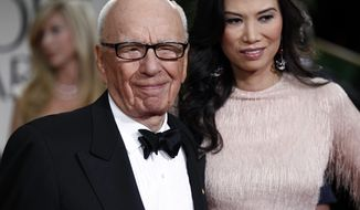 ** FILE ** Media mogul Rupert Murdoch and his wife, Wendi Deng, arrive at the 69th annual Golden Globe Awards in Los Angeles on Sunday, Jan. 15, 2012. (AP Photo/Matt Sayles)