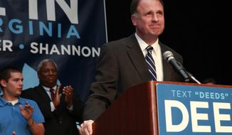 FILE - In a Tuesday, Nov. 3, 2009 file photo, Democratic gubernatorial candidate and Virginia state Sen. Creigh Deeds makes a speech to supporters after losing the Virginia governor's race to Republican Bob McDonnell, in Richmond, Va. At far left is Deed's son, Gus Deeds. Virginia State Police confirmed Tuesday, Nov. 19, 2013 that Creigh Deeds was stabbed multiple times and his son Gus, 24, was shot and killed at Deeds' Home in Bath County, Va., during a Tuesday morning assault. (AP Photo/Jacquelyn Martin, File)