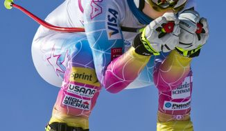 FILE - In this Nov. 7, 2013 file photo, Lindsey Vonn speeds down the training course at the U.S. Ski Team training center at Copper Mountain, Colo. Reigning Olympic downhill champion Vonn has crashed while training ahead of her return to racing following major knee surgery. U.S. Ski Team spokesman Tom Kelly says Tuesday, Nov. 19, 2013,  that Vonn is being evaluated at a hospital after being taken off the slope at Copper Mountain, Colo., on a sled. (AP Photo/Nathan Bilow, File)