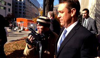 "This photo taken with a cellphone shows Rep. Henry ""Trey"" Radel, R-Fla. leaving court in Washington, Wednesday, Nov. 20, 2013, leaving court after pleading guilty to a misdemeanor charge of cocaine possession and was sentenced to a year's probation. (AP Photo/Jessica Gresko)"