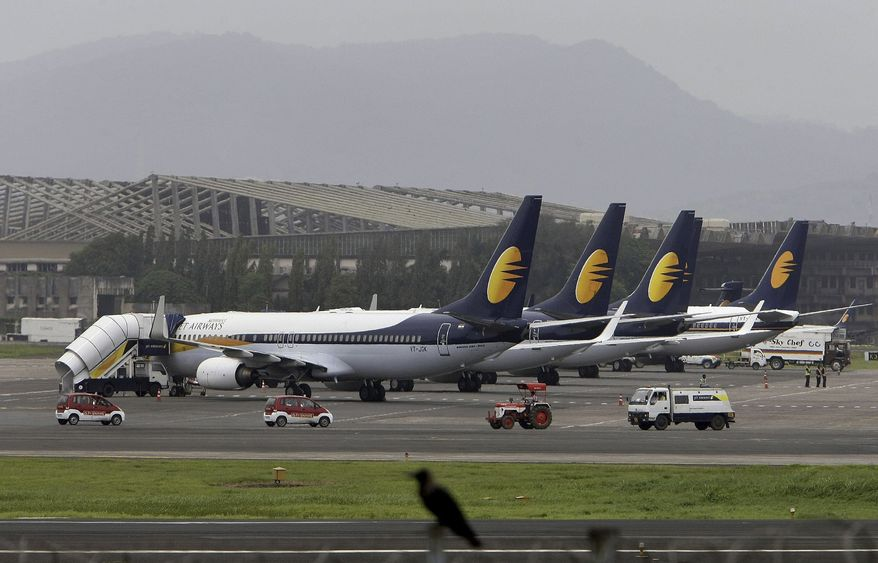 ** FILE ** Jet Airways planes sit on the apron at the domestic terminal at the Mumbai airport in 2009. (AP Photo/Rajanish Kakade)