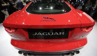 The Jaguar F-Type Coupe is introduced at the Los Angeles Auto Show in Los Angeles, Wednesday, Nov. 20, 2013. (AP Photo/Chris Carlson)