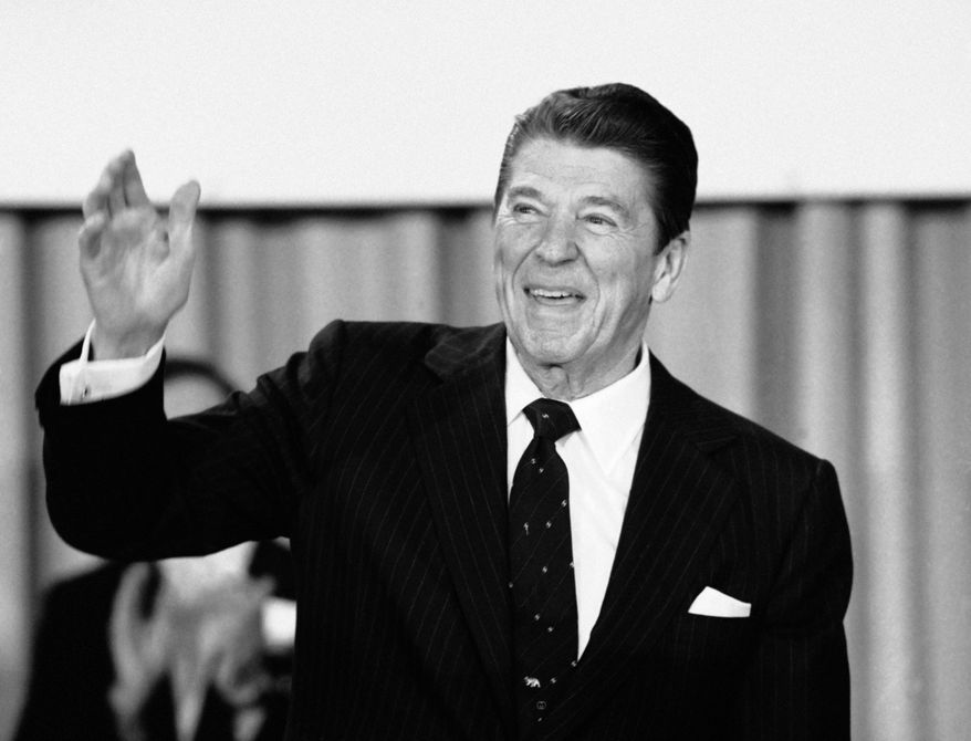 FILE - In this March 30, 1981 file photo, President Ronald Reagan acknowledges applause before speaking to the Building and Construction Trades Department of the AFL-CIO at a Washington hotel. In 1981, Reagan signed an executive order that extended the power of U.S. intelligence agencies overseas, allowing broader surveillance of non-U.S. suspects. Recent reports that the National Security Agency secretly broke into communications on Yahoo and Google overseas have technology companies, privacy advocates and even national security proponents calling for a re-examination of Reagan's order and other intelligence laws. (AP Photo/Ron Edmonds, File)