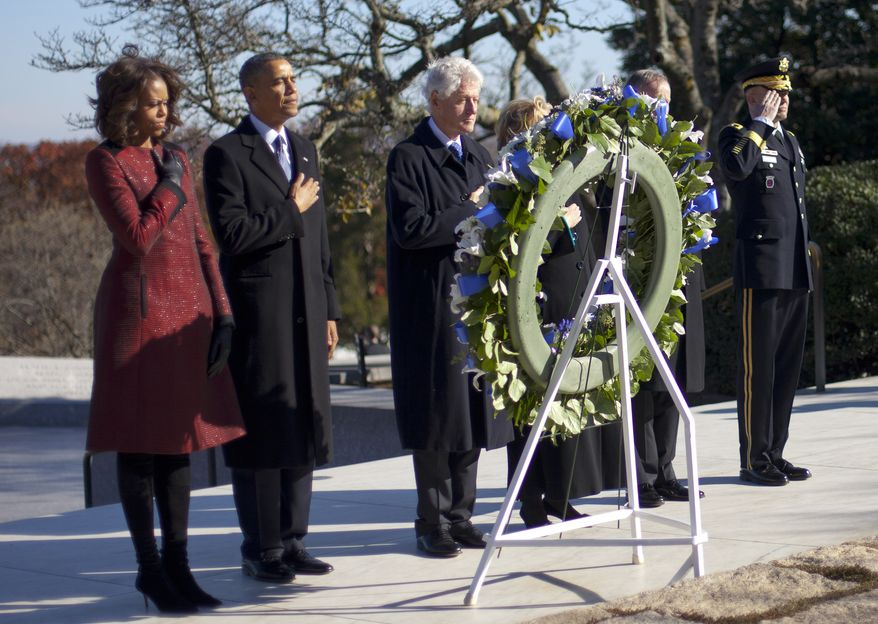 President Barack Obama, first lady Michelle Obama, former President Bill Clinton and his wife former Secretary of State Hillary Rodham Clinton, pause during a wreath laying ceremony in honor of President John F. Kennedy, Wednesday, Nov. 20, 2013, at Arlington National Cemetery in Arlington, Va. Friday will mark the 50th anniversary of the Kennedy assassination. (AP Photo/Pablo Martinez Monsivais)
