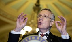 Senate Majority Leader Sen. Harry Reid, D-Nev., speaks to the media on Capitol Hill in Washington, Tuesday, Nov. 19, 2013. The Senate is nearing a potential showdown on curbing the power that the Republican minority has to block President Barack Obama's nominations, as Democrats edge toward muscling a rewrite of filibuster rules through the chamber. Reid was expected to force a vote as soon as Thursday on requiring only 51 votes to end filibusters, or delaying tactics, against nominees for high-level judgeships and agency officials. (AP Photo/Manuel Balce Ceneta)