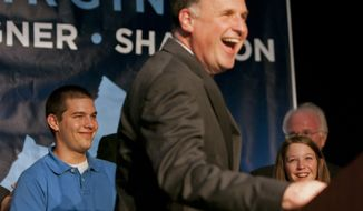 In this photo in Richmond, Va. on Tuesday, Nov. 3, 2009, Gus Deeds, left, attends an election results event with his father, Democratic gubernatorial candidate and Virginia State Sen. Creigh Deeds, after his loss in the Virginia governor's race against Republican Bob McDonnell. Virginia State Police confirmed Tuesday, Nov. 19, 2013, that Creigh Deeds was stabbed multiple times and his son Gus, 24, was shot and killed at Deeds' Home in Bath County, Va., during a Tuesday morning assault. (AP Photo/Jacquelyn Martin)