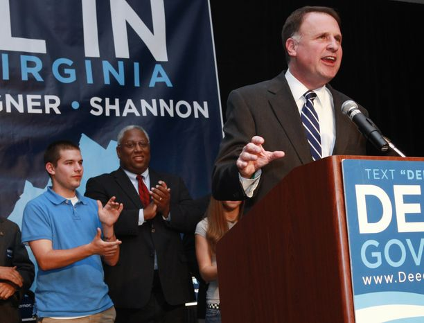 In this photo in Richmond, Va. on Tuesday, Nov. 3, 2009, Gus Deeds, left, attends an election results event for his father, Democratic gubernatorial candidate and Virginia State Sen. Creigh Deeds, at right, after his loss in the Virginia governor's race against Republican Bob McDonnell. Virginia State Police confirmed Tuesday, Nov. 19, 2013, that Creigh Deeds was stabbed multiple times and his son Gus, 24, was shot and killed at Deeds' Home in Bath County, Va., during a Tuesday morning assault. (AP Photo/Jacquelyn Martin)