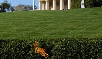 Arlington House sits atop a hill overlooking the eternal flame at the grave site of former President John F. Kennedy at Arlington National Cemetery.