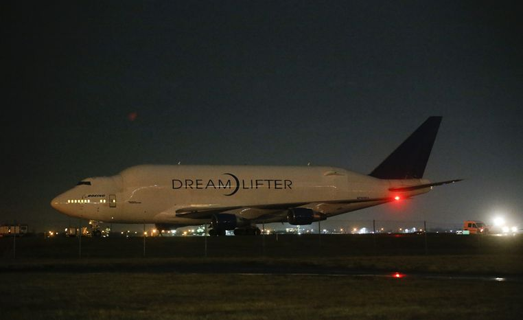 A Boeing 747 Dreamlifter sits on the runway after accidentally landing at Col. James Jabara Airport in Wichita, Kan., instead of the nearby McConnell Air Force Base on Wednesday, Nov. 20, 2013. (AP Photo/Wichita Eagle,