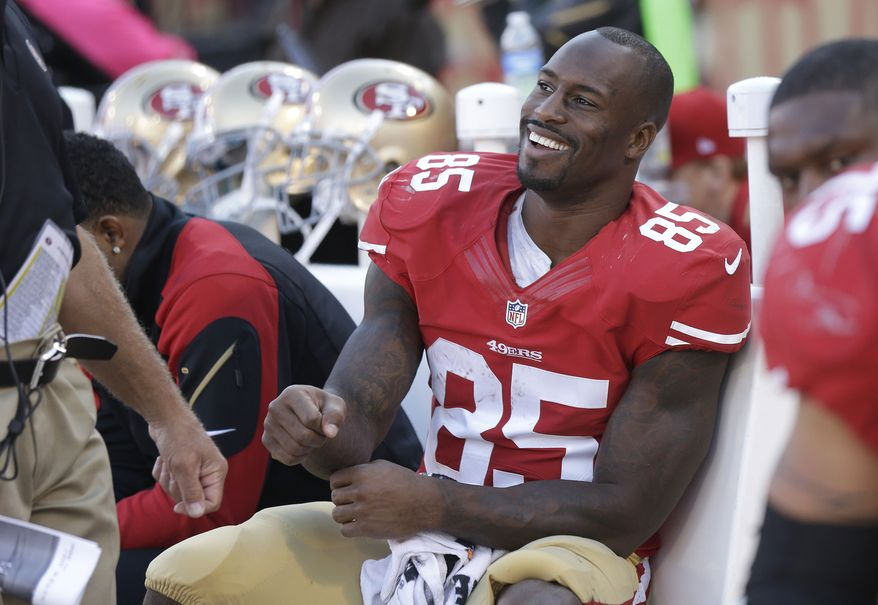 San Francisco 49ers tight end Vernon Davis (85) smiles on the bench during the fourth quarter of an NFL football game against the Arizona Cardinals in San Francisco, Sunday, Oct. 13, 2013. The 49ers won 32-20. (AP Photo/Marcio Jose Sanchez)