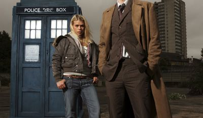 "A 2006 handout photo made available by the BBC from an episode of ""Doctor Who"" showing Billie Piper, left, as Rose Tyler and David Tennant as The Tenth Doctor. ""Doctor Who"" is turning 50 and the BBC is throwing a broadcasting blowout for the sci-fi show, which began with little fanfare and few expectations on Nov. 23, 1963 but is now one of its biggest hits and major exports. (AP Photo/BBC, Mike Hogan)"