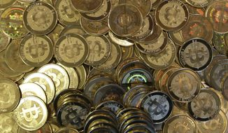 **FILE** Bitcoin tokens are pictured in Sandy, Utah, on April 3, 2013. (Associated Press)