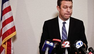Rep. Trey Radel, Florida Republican, takes a moment to himself as he addresses the media at his office in Cape Coral, Fla., on Wednesday, Nov. 20, 2013. Earlier in the day, Mr. Radel pleaded guilty to misdemeanor cocaine possession and received one year's probation. (AP Photo/Naples Daily News, Scott McIntyre)