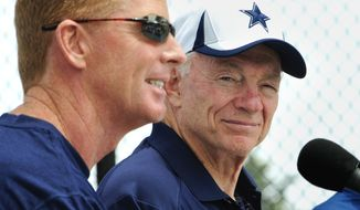 FILE - In this July 20, 2013, file photo, Dallas Cowboy owner Jerry Jones, right, looks on as head coach Jason Garrett, left, answers a question from the media during the state of the Cowboys news conference at NFL football training camp in Oxnard, Calif. Jones said Thursday, Nov. 21, 2012, that Garrett will return in 2014 regardless of whether or not the Cowboys end a three-year playoff drought this season. (AP Photo/Gus Ruelas, File)