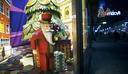 A Santa Claus figurine is part of a holiday window display at Macy's, Thursday, Nov. 21, 2013, in New York. (AP Photo/Mark Lennihan)