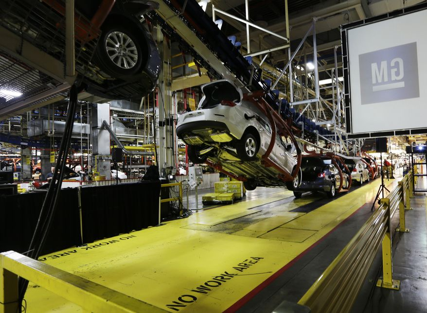 ** FILE ** In this Monday, Jan. 28, 2013, file photo, cars move along an assembly line at the General Motors Fairfax plant in Kansas City, Kan.  The U.S. government expects to sell the last of its stake in General Motors by the end of 2013, bringing an end to a sad chapter in the 105-year-old auto giant's history. (AP Photo/Orlin Wagner, File)