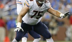 FILE - In this Sept. 29, 2013, file photo, Chicago Bears offensive guard Kyle Long (75) plays during the fourth quarter of an NFL football game against the Detroit Lions at Ford Field in Detroit. Brothers Kyle and Chris Long go head-to head in Sunday's Nov. 24, 2013, Bears-Rams game while father Howie Long, a Hall of Famer, looks on. (AP Photo/Paul Sancya, File)