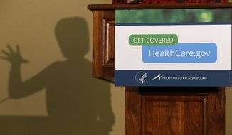 ** FILE ** In this Friday, Nov. 15, 2013, photo, the shadow of Health and Human Services Secretary Kathleen Sebelius is shown as she speaks at the Community Health and Social Services Center in Detroit. Technology experts say healing what ails the HealthCare.gov website will be a tougher task than the Obama administration acknowledges. (AP Photo/Paul Sancya, File)