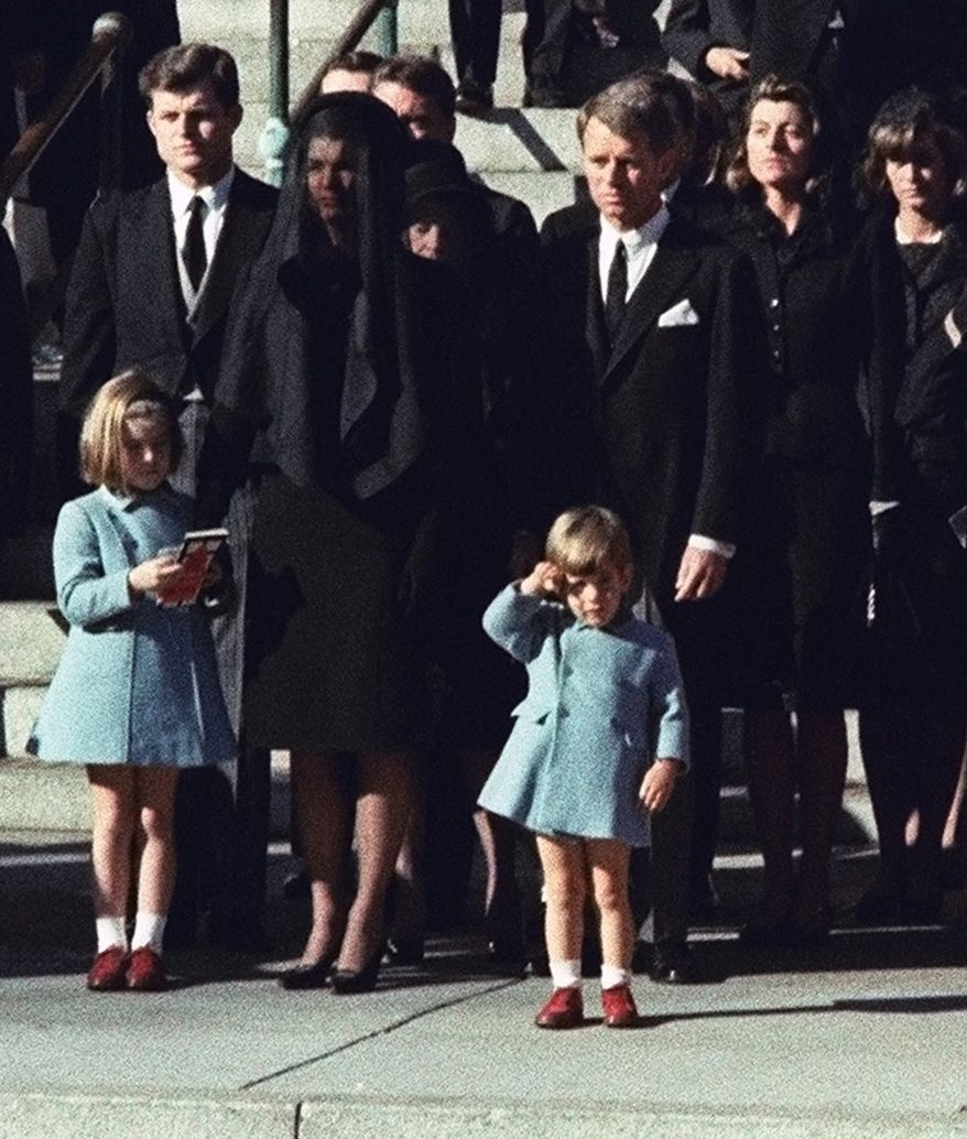 FILE - In this Monday, Nov. 25, 1963 file photo, 3-year-old John F. Kennedy Jr. salutes his father's casket in Washington, three days after the president was assassinated in Dallas. Widow Jacqueline Kennedy, center, and daughter Caroline Kennedy are accompanied by the late president's brothers Sen. Edward Kennedy, left, and Attorney General Robert Kennedy. (AP Photo/File)