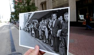 This Nov. 7, 2013 photo shows an image taken Nov. 21, 1963, of people lining Travis Street near Rusk Street to see U.S. President John F. Kennedy's motorcade during a visit to Houston, juxtaposed against the current scene in Houston. (AP Photo/Houston Chronicle, Cody Duty)