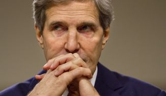 ** FILE ** Secretary of State John Kerry listens on Capitol Hill in Washington, Thursday, Nov. 21, 2013, during a Senate Foreign Relations Committee.  (AP Photo/Jacquelyn Martin)