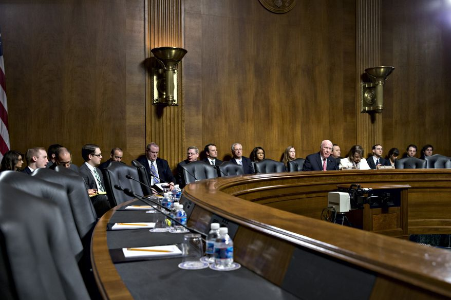 Senate Judiciary Committee Chairman Sen. Patrick Leahy, D-Vt., seated at center right, expresses frustration as the seats on the Republican side of the panel remain empty, causing the cancellation of an executive meeting to consider a dozen of President Barack Obama's judicial nominations, Thursday, Nov. 21, 2013, on Capitol Hill in Washington. The Senate is nearing a potential showdown on curbing the power that the Republican minority has to block President Barack Obama's nominations, as majority Democrats edge toward forcing a rewrite of filibuster rules through the chamber require only 51 votes to end filibusters and other delaying tactics. (AP Photo/J. Scott Applewhite)