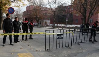 Security officials close a road leading to Turkish Prime Minister Recep Tayyip Erdogan's office shortly after police subdued a man who was carrying a fake bomb in Ankara, Turkey, Thursday, Nov. 21. 2013. Police fired two warning shots in the air before overpowering and arresting him, said an aide to the prime minister. The 53-year-old man, identified as Tugrul B., was carrying a device made to look like a bomb, the official said. He was being questioned and the motive for his action was not immediately known. (AP Photo/Burhan Ozbilici) (AP Photo/Burhan Ozbilici)