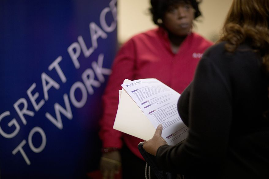 Jimmetta Smith (right) of Lithonia, Ga., the wife of a U.S. Marine veteran, holds her resume while talking with Rhonda Knight, a senior recruiter for Delta Air Lines, at a job fair for veterans and family members at Veterans of Foreign Wars Post 2681 in Marietta, Ga., on Thursday, Nov. 14, 2013. (AP Photo/David Goldman)