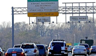 **FILE** The Dulles Toll Road in Northern Virginia (The Washington Times)