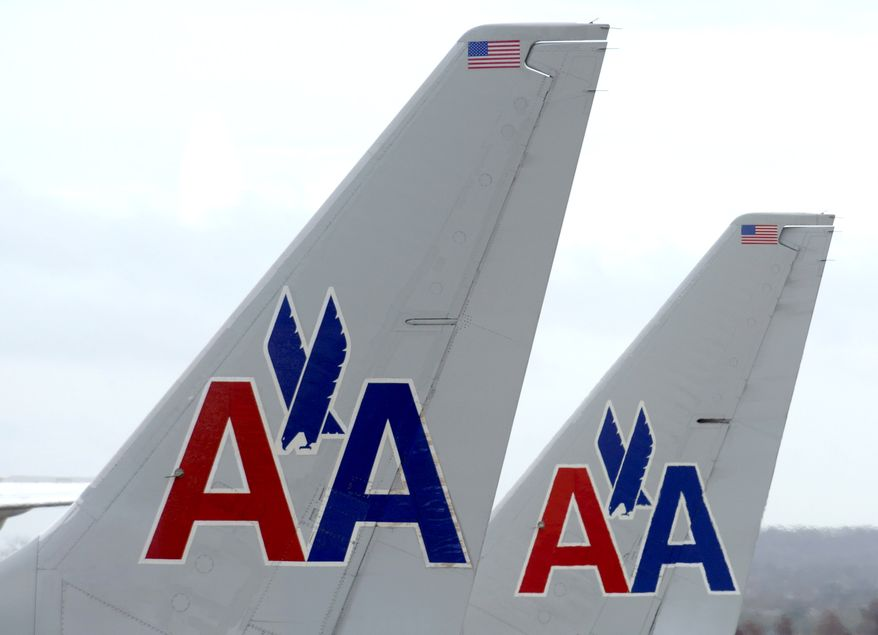 FILE - In this Tuesday, Nov. 29, 2011, file photo, American Airline planes sit at a gate at Washington's Ronald Reagan National Airport.  Four key members of Congress said Friday, Nov. 22, 2013, that all airlines should be able to bid on gates and landing rights that American Airlines and US Airways will give up after their merger. (AP Photo/Susan Walsh)
