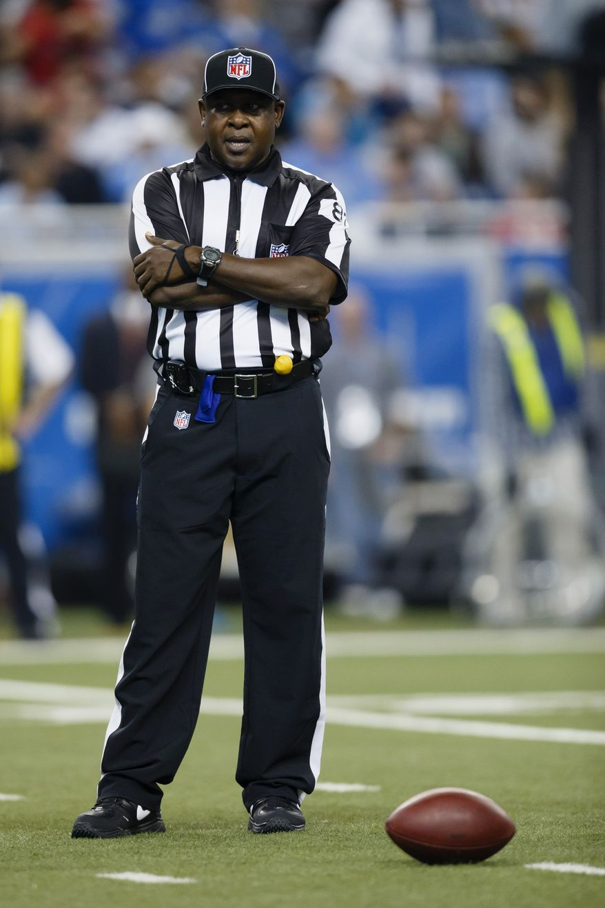 **FILE** Umpire Roy Ellison (81) during an NFL football game between the Detroit Lions and the Houston Texans at Ford Field in Detroit, Thursday, Nov. 22, 2012. (AP Photo/Rick Osentoski)
