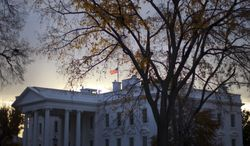 ** FILE ** A flag flies at half-staff above the White House in Washington early Friday morning, Nov. 22, 2013. President Barack Obama ordered that flags be lowered at government buildings to mark the 50th anniversary of President John F. Kennedy's assassination. (AP Photo/Pablo Martinez Monsivais)