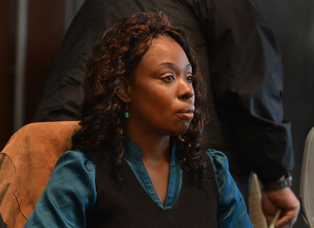 A tear runs down Crystal Mangum's face as her verdict of being guilty of second-degree murder is read Friday Nov. 22, 2013 in the stabbing death of her boyfriend, Reginald Daye, in 2011. Superior Court Judge Paul Ridgeway sentenced Mangum to a minimum of 14 years and two months to a maximum of 18 years in prison. (AP Photo/ The News & Observer, Chuck Liddy)