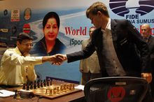 Norway's Magnus Carlsen, right, shakes hands with reigning world chess champion India's Viswanathan Anand during the Chess World Championship match in Chennai, India, Friday, Nov. 22, 2013. (AP Photo/Arun Sankar K.)