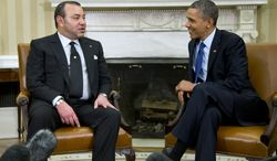President Barack Obama meets with Morocco's King Mohammed VI, Friday, Nov. 22, 2013, in the Oval Office of the White House in Washington. (AP Photo/ Evan Vucci)