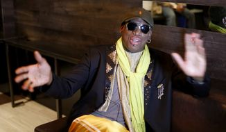 In this Thursday, Nov. 21, 2013, photo, Dennis Rodman gestures during an interview after a promotional event to pitch a vodka brand in Chicago. (AP Photo/Charles Rex Arbogast)