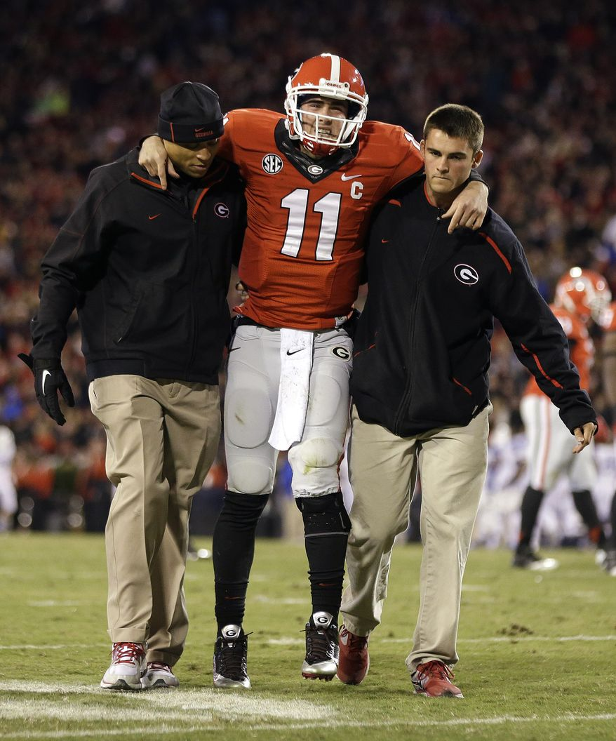 Georgia quarterback Aaron Murray (11) is helped off the field after being injured in the first half of an NCAA college football game against Kentucky, Saturday, Nov. 23, 2013, in Athens, Ga. (AP Photo/John Bazemore)