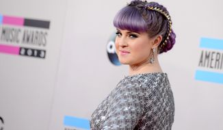 Kelly Osbourne arrives at the American Music Awards at the Nokia Theatre L.A. Live on Sunday, Nov. 24, 2013, in Los Angeles. (Photo by Jordan Strauss/Invision/AP)