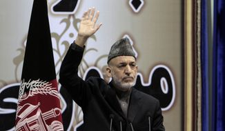 Afghan President Hamid Karzai attends the last day of the national consultative council known as a Loya Jirga in Kabul, Afghanistan, on Sunday, Nov. 24, 2013. Mr. Karzai said he won't immediately sign a security deal with the United States, ignoring a recommendation by the assembly of Afghan elders and leaders that he do so by the end of the year. The president argued that Afghanistan needs more time to ensure that the United States is committed to peace. (AP Photo/Rahmat Gul)