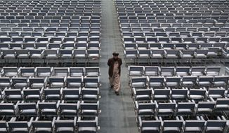 A member of the Afghan national consultative council known as the Loya Jirga leaves after the last day of the assembly in Kabul, Afghanistan, Sunday, Nov. 24, 2013. (AP Photo/Rahmat Gul)