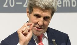 U.S. Secretary of State John F. Kerry gestures as he speaks to the media about the deal that six world powers and Iran have reached calling for Tehran to limit its nuclear activities in return for sanctions relief, at the International Conference Center of Geneva on Sunday, Nov. 24, 2013, in Geneva, Switzerland. (AP Photo/Carolyn Kaster, Pool)