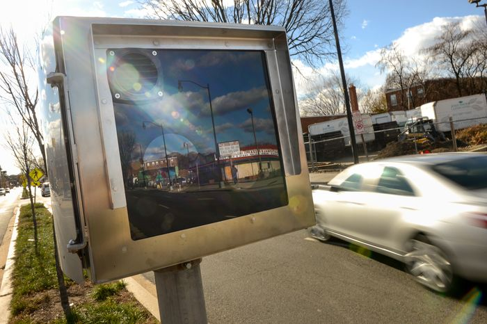 A speed camera sits in the center median along Bladensburg Road in Northeast, Washington, D.C., Sunday, November 24, 2013. The Washington Metropolitan Police Department has added 100 new traffic camer